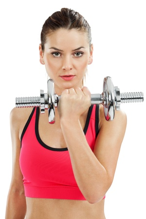 barbell: an attractive female doing dumbbell curls over white background