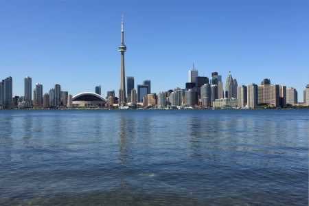 Photo of the Toronto skyline under a clear sky. photo