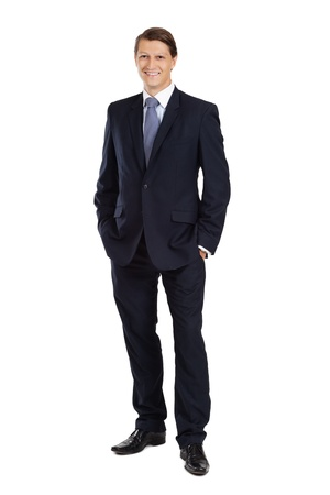 businessman standing:  an attractive businessman smiling over a white background.
