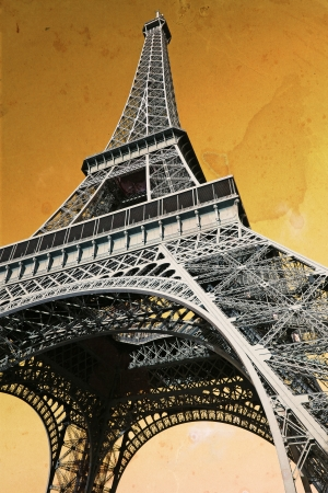 The Eiffel Tower in Paris France, done with vintage feel with old paper background. photo