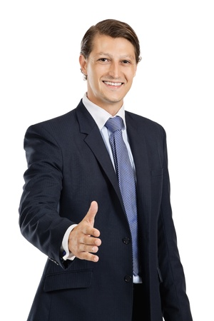 late twenties: Photo of an attractive businessman in his late twenties extending his hand out.