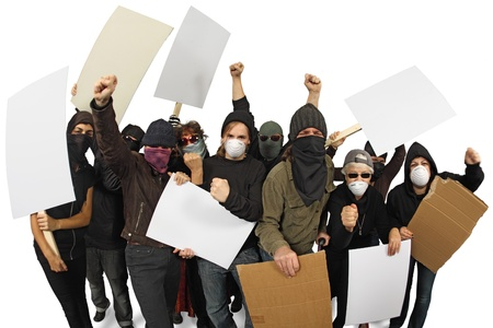 Photo of a group of angry protesters wearing masks and holdings signs. Shot with Fisheye lens with focus on middle people. Stock Photo