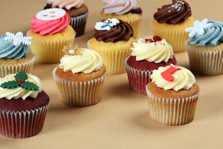 Photo of many cupcakes decorated for Christmas. Focus across the middle. Stock Photo - 16991173