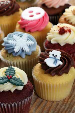Photo of many cupcakes decorated for Christmas. Focus on snowman. Stock Photo - 16991168