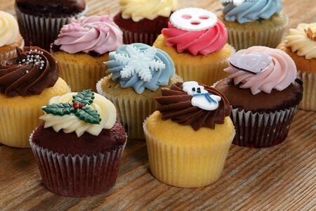 Photo of many cupcakes decorated for Christmas. Focus across the middle. Stock Photo - 16991172