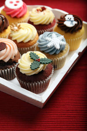 Photo of many cupcakes decorated for Christmas on a white tray. Focus on closest cupcake. Stock Photo - 17093894