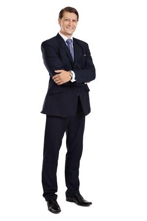 uomo felice: Foto di un uomo d'affari attraente con le braccia incrociate e sorridente su uno sfondo bianco.