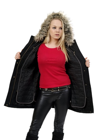Young beautiful blond female opening her winter jacket to show the blank red t-shirt she is wearing. Ready for your design or artwork. photo