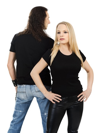 Photo of a man and woman posing with blank black shirts. Male is facing backwards so a custom shirt design can be shown on front and back. photo