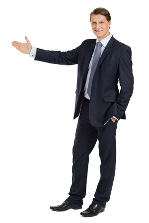 Photo of a handsome young businessman pointing to something.