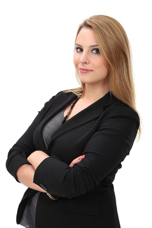 Photo of a young blond business woman standing with her arms crossed. Stock Photo - 17625081