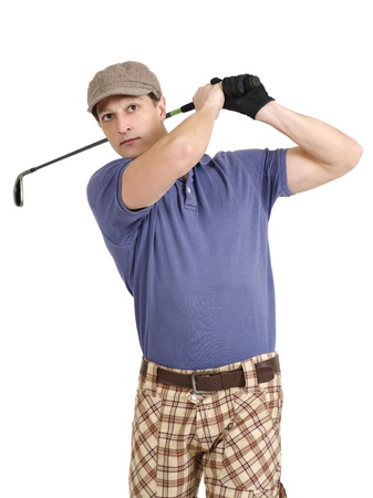 late twenties: Photo of a male golfer in his late twenties finishing his swing with a wedge.