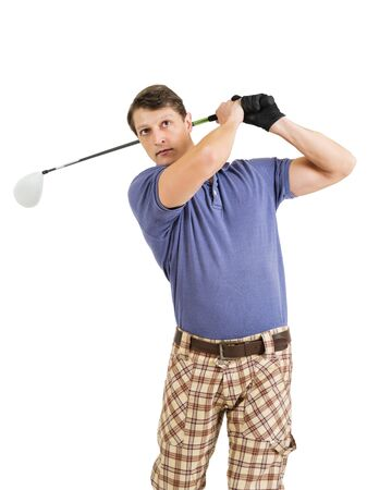 late twenties: Photo of a male golfer in his late twenties finishing his swing with a driver.