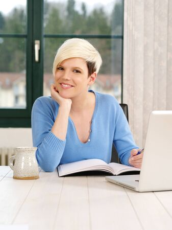 a successful young businesswoman with laptop computer in office. photo