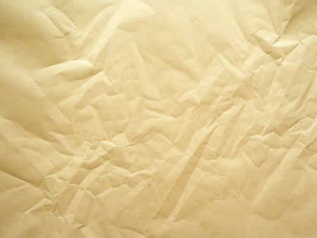 has been: Photo of a sheet a packing paper that has been crumpled.