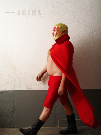 Photograph of a Mexican wrestler or Luchador walking to the wrestling arena photo