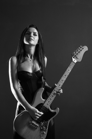sexy guitar: Photo of a female guitarist playing an electric guitar