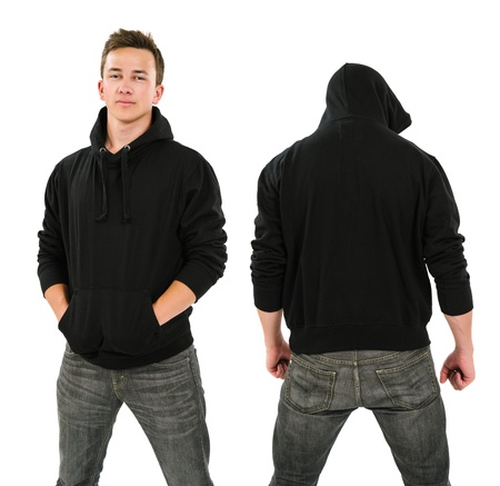 Photo of a male in his late teens posing with a blank black hoodie   Front and back views ready for your artwork or designs