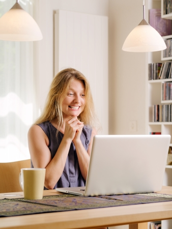 Photo of a beautiful young female excited about shopping online and drinking coffee.  photo