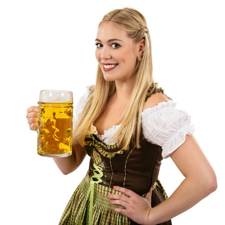 Photo of a beautiful female waitress wearing traditional dirndl and holding a huge beer over white background. photo