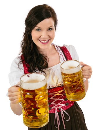stein: Photo of a beautiful female waitress wearing traditional dirndl and holding huge beers over white background. Stock Photo
