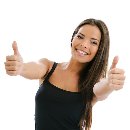 Photo of an excited young female doing the two thumbs up gesture over white background.