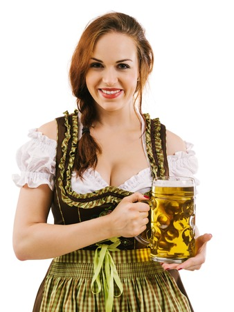 alcohol server: Photo of a beautiful female waitress wearing traditional dirndl and holding a huge beer over white background. Stock Photo
