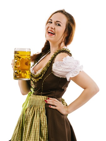 Photo of a beautiful happy woman wearing traditional dirndl, laughing and holding a huge beer.  photo