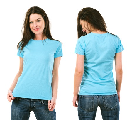 Photo of a beautiful brunette woman with blank light blue shirt. Ready for your design or artwork. Фото со стока