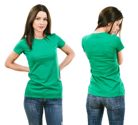 Photo of a beautiful brunette woman with blank green shirt. Ready for your design or artwork. Фото со стока