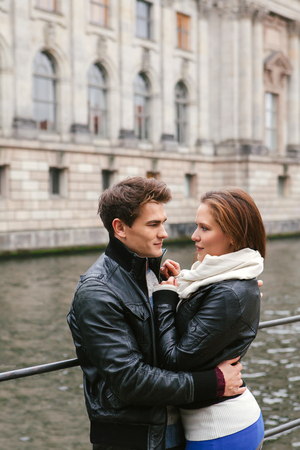 microstock: happy couple embracing by a river in autumn. Photo is from the PhotoWalk in Berlin during Microstock Expo.