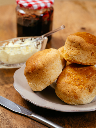 scone: delicious scones on a plate with clotted cream and jam.
