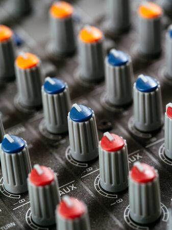 soundboard: Macro photo of the knobs of a recording studio soundboard.