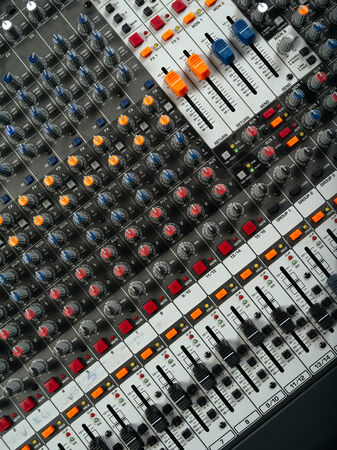 Photo of a recording studio mixer from above. photo
