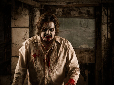 Photo of a hungry zombie covered with blood about to attack you. photo