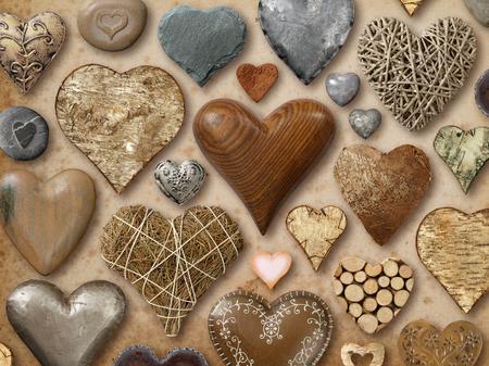 돌, 금속, 나무로 만든 하트 모양의 가지의 배경입니다.