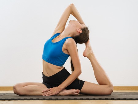 yoga girl: Photo of a young woman in her twenties doing yoga.