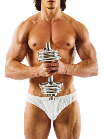 underpants: Photo of a muscular man posing in his underwear and holding a dumbbell.