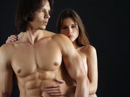 Photo of a topless young woman and man in love. Stock Photo