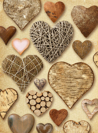 Background of heart-shaped things made of wood on vintage paper background. photo
