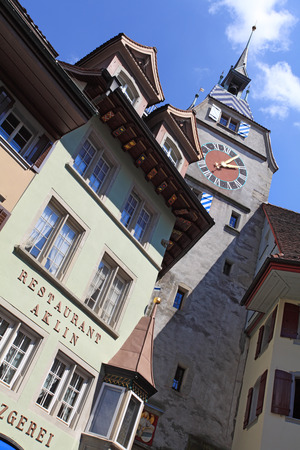 clocktower: ZUG, SWITZERLAND ? May 3, 2012 ? Zytturm clocktower in the old town section of the city of Zug in Switzerland.