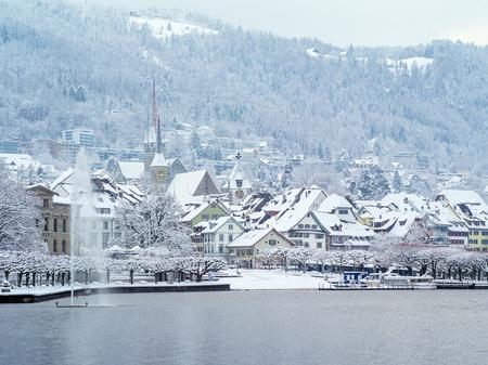 december 31: ZUG, SWITZERLAND ? December 31, 2014 ? City of Zug Switzerland in January after a long snowstorm. Editorial