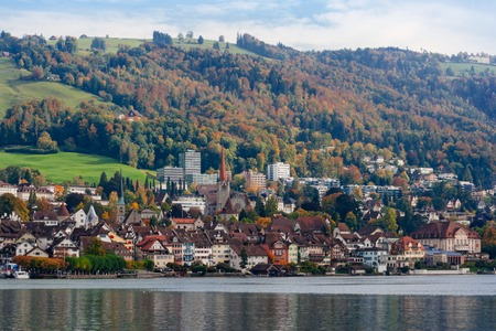 Photo of the city of Zug in Switzerland. Taken from across the lake of Zug during October. Фото со стока