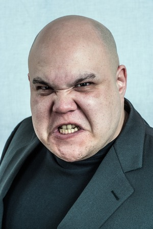 bald ugly: Photo of an angry bald man grimacing at the camera. Filtered to be more creepy. Stock Photo
