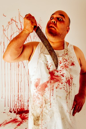 Crazy insane butcher covered with blood.  Harsh lighting for more disturbing feel.