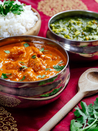 curry chicken: Photo of an Indian meal of Butter Chicken, rice and Saag Paneer