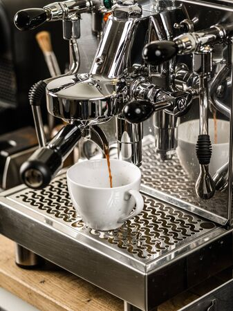 machine made: Photo of an espresso being made with a professional coffee machine.