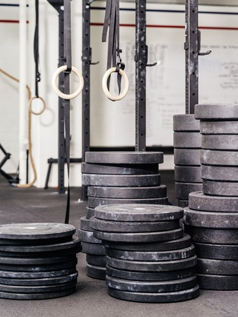 indoor background: Background photo of stacks barbell weights or plates at a indoor gym. Stock Photo