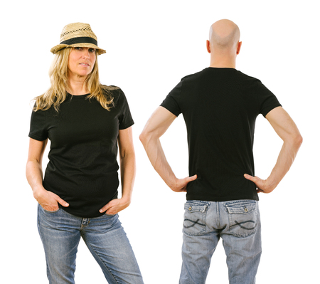 white men: Photo of a woman and a man posing with a blank black t-shirt, ready for your artwork or design. Stock Photo