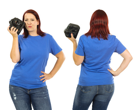 buxom: Photo of a woman posing with a blank blue t-shirt and holding a camera, ready for your artwork or design.